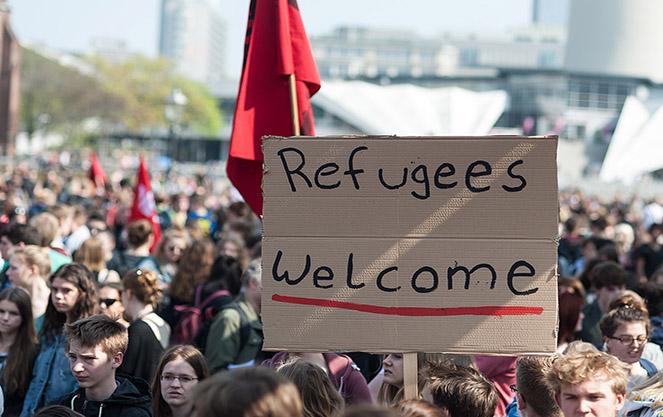 Беженцы в италии